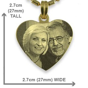 A medium gold plated silver heart etched with your favourite photo.